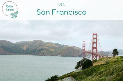 """Titelbild mit Text """"USA - San Francisco""""; Bild zeigt die Golden Gate Bridge von einem Hügel aus mit Blick über die Bucht"""
